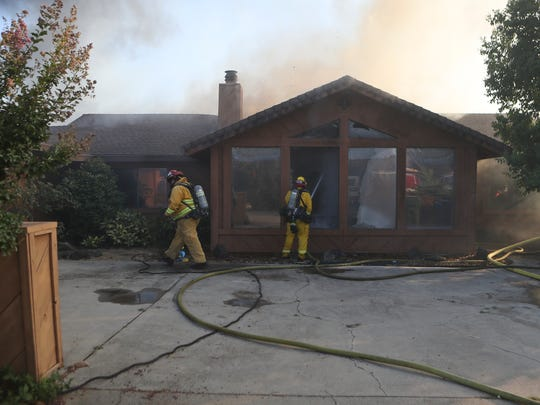 Redding firefighters work to save a home off of Teakwood Drive in Redding.