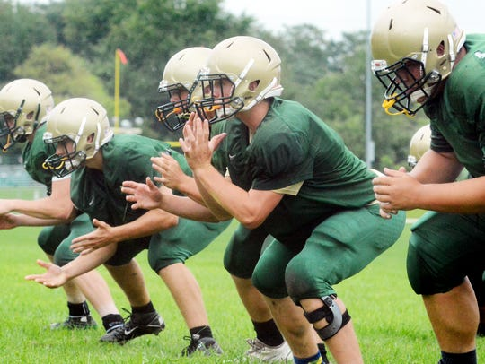 York Catholic linemen run through a drill during practice