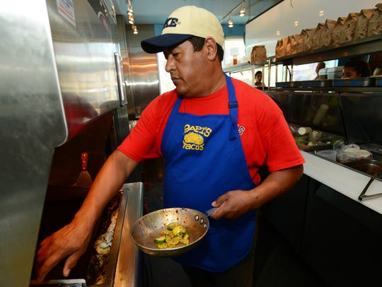 Jorge Barrales, executive chef of Papi's Tacos, prepares