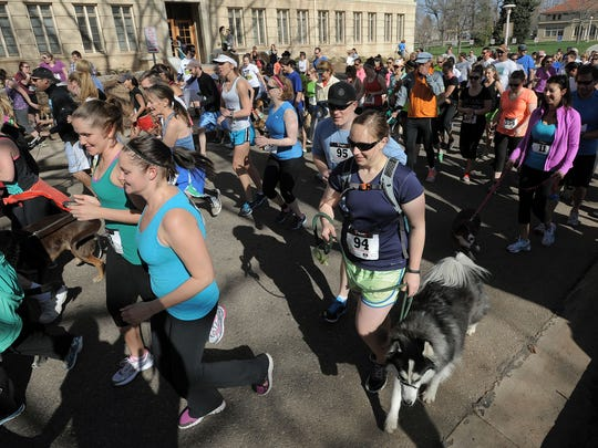 Competitors are shown during the 10th annual Fast and the Furriest 5K at the CSU Oval Saturday April 27, 2013. The race will take place on May 20 this year.