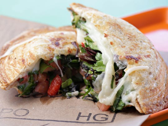 The fresh mozzarella sandwich at Zookz in Phoenix is a tasty medley of tomatoes, fresh spinach, roasted red peppers and fresh basil, all sealed in country bread that is baked on-site.