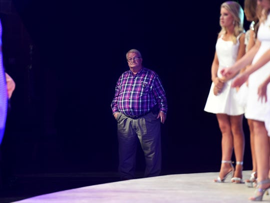Robert Boren stands off stage during rehearsals for