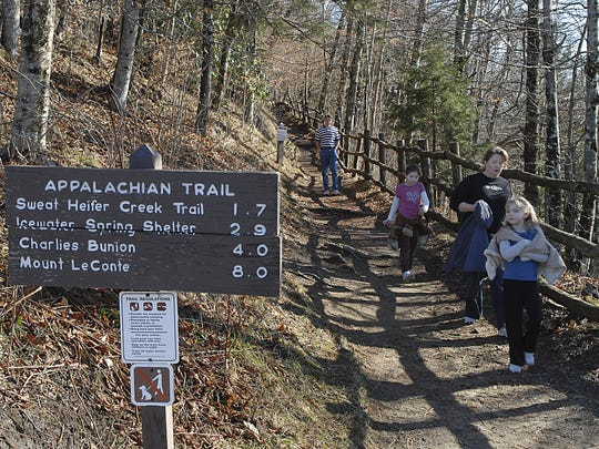 Day hikers come off the Appalachian Trail at the Newfound