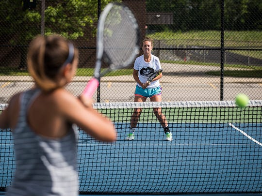 Delta's No. 1 doubles team Sarah Ogle and Emily Decker practice together at Delta High School Tuesday morning.