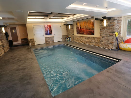 A wave pool was installed in the former garage. The aquatic center, as the homeowners call it, also has a hot tub.