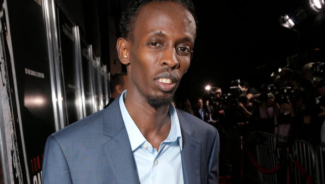 """Barkhad Abdi at the special screening of """"Captain Phillips"""" in Beverly Hills, Calif. Abdi was nominated for a Golden Globe for best supporting actor in a motion picture for his role in the film on Thursday, Dec. 12, 2013.  The 71st annual Golden Globes will air on Sunday, Jan. 12."""