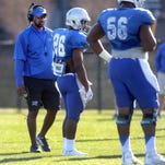 MTSU's new running back Coach Jeff Beckles works with players during MTSU's football practice, on Tuesday March 22, 2016.