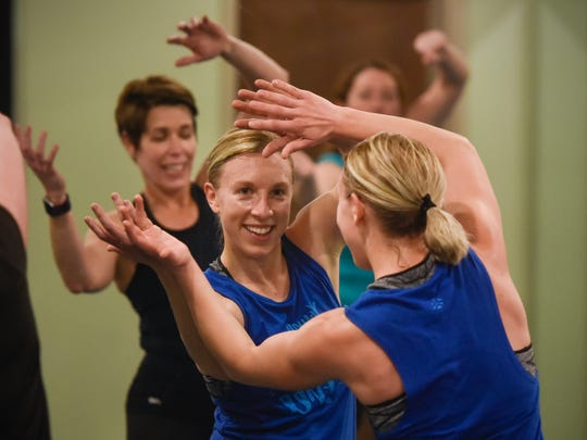 Group fitness instructor Kristen Boldt smiles while leading a cardio dance class Wednesday, March 22, at Rejuv Medical in Waite Park.