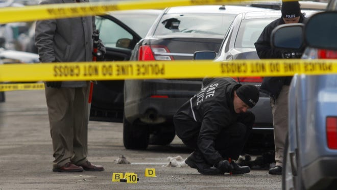 Police work near evidence markers on March 31, 2014.