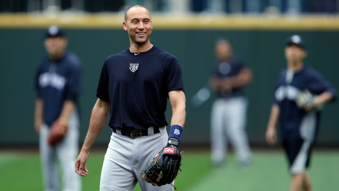 Yankees shortstop Derek Jeter fields balls during batting practice on Tuesday before a game in Seattle.
