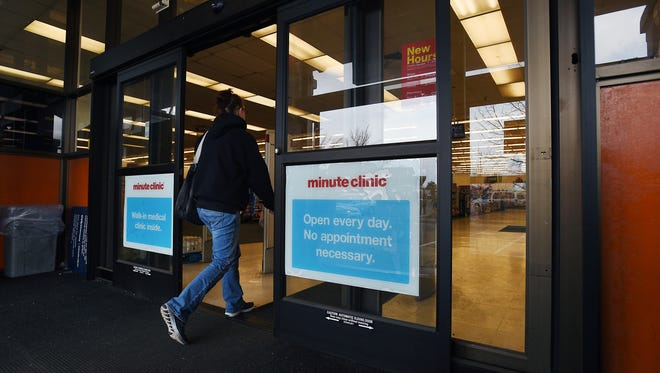A customer walks into a CVS Pharmacy in Sparks in this RGJ file photo.