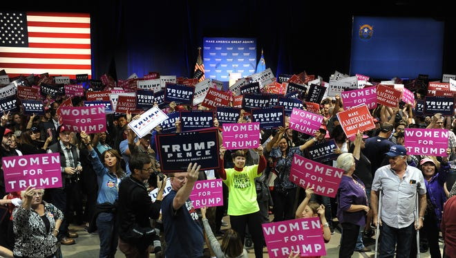 Supporters wait for Republican candidate for president Donald Trump to speak during a campaign rally at the Reno-Sparks Convention Center in Reno on Saturday.