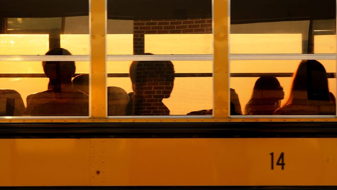 Students ride the bus to school at Shelburne Middle School in Staunton in this 2012 file photo.