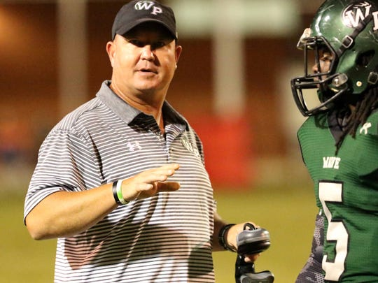 West Point High School Head Coach Chris Chambless, left   speaks to Antrayvious Brownlee (5) during the first half of their Friday night Oct. 13, 2017 football game against Olive Branch High School in West Point, Miss. (Special to the Clarion Ledger/Jim Lytle)