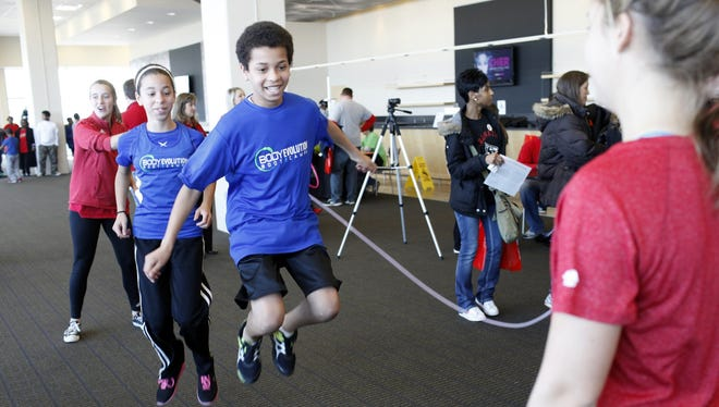 In this archived photo, kids jump rope at the Healthy Family Training Camp.