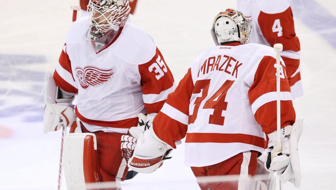 Red Wings goalie Petr Mrazek (34) is brought to the ice to replace goalie Jimmy Howard (35) during the second period of the Wings' 4-1 loss Tuesday in Winnipeg, Manitoba.