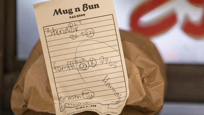 Restaurant short hand being used on a ticket for a to go order at Mug-n-Bun, Indianapolis, Friday, May 18, 2018. Situated about a mile from the Indianapolis Motor Speedway, Mug-n-Bun runs at full tilt during Indy 500 week, but shuts down during race Sunday, as the streets near it are blocked. The business, which serves many of the dishes you would see at the State Fair, has been going since 1960, and uses car hops to take orders and deliver items on a window-mounted trays. A separate picnic area and building exists for people who don't have an auto, or choose to not eat in their car.