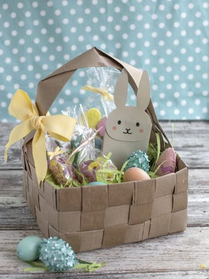 A DIY Easter basket is made from four brown paper grocery bags, cut into strips and woven together. Fresh takes on Easter baskets for kids include a heavy dose of do-it-yourself ingenuity.