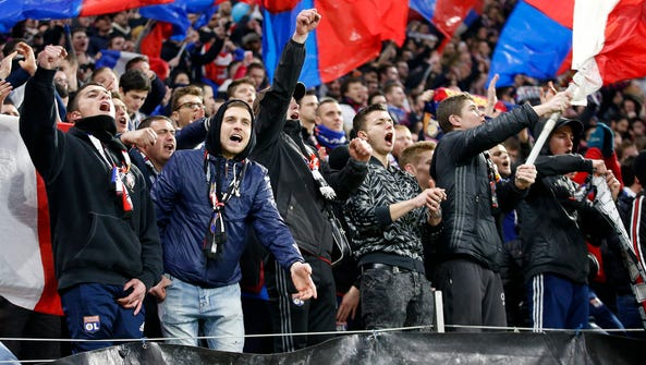 Supporters of Olympique Lyon cheer for their team during