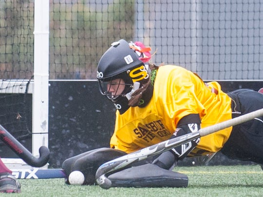 Salisbury goalkeeper Rachel Clewer makes a diving save against Wellesley in the third round of the Division 3 NCAA Field Hockey tournament on Sunday afternoon at Sea Gull Stadium.