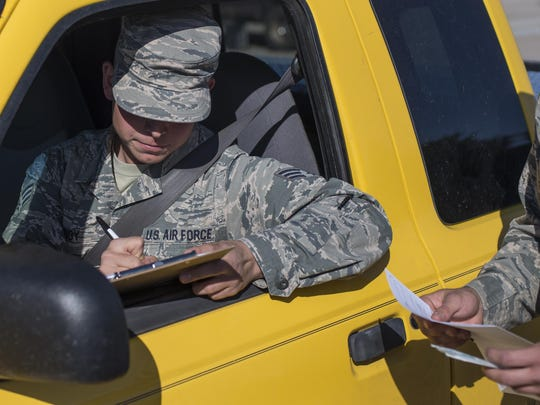 """Senior Airman Bryce Bigboy, a 49th Material Maintenance Squadron metals technician, fills out a consent form during the 49th Medical Group's Swab-Thru event, at Holloman Air Force Base, N.M. on April 20, 2017. The Swab-Thru, coordinated with the """"Salute to Life"""" program, is a special drive-thru bone marrow registration event."""