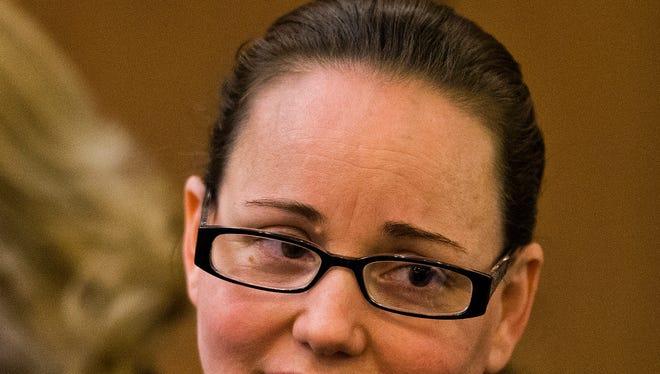 Marissa DeVault smiles at her attorney after a jury sentenced DeVault to life in prison. The verdict came down in the Maricopa County Superior Courtroom of Judge Roland Steinle III, Wednesday, April 30, 2014.  DeVault was found guilty of killing her husband by hitting him in the head with a hammer.