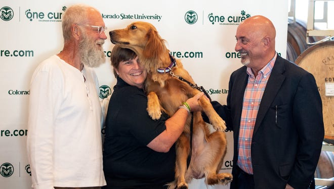David Letterman and Bobby Rahal greet a client of the CSU James L. Voss Veterinary Teaching Hospital during a visit to the Flint Animal Cancer Center. Letterman and Rahal, owners of Rahal Letterman Lanigan Racing and the One Cure car, toured the Lucy Oncology Clinic and visited with the oncology staff at the veterinary teaching hospital on Tuesday.