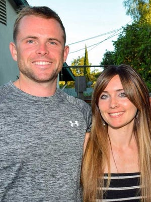 Marine Staff Sgt. Robert Cox, who was killed in a military plane crash in July, is pictured with his sister Amber Cox.