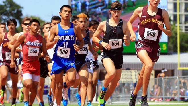 GABE HERNANDEZ/CALLER-TIMES Tuloso-Midway's Ace Castillo competes in the 1,600-meter run during the Region IV-5A Track & Field Meet Saturday at Alamo Stadium in San Antonio. Castillo won the event.