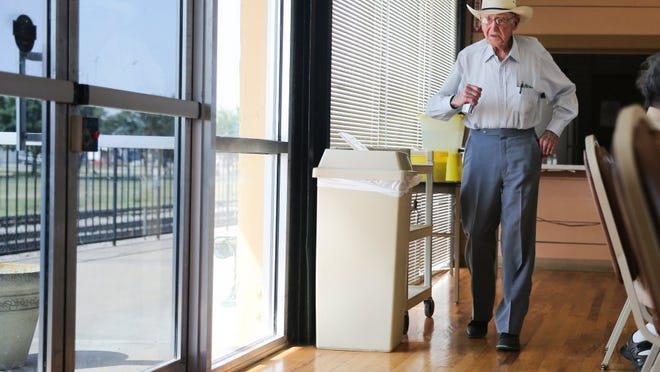 Yfat Yossifor / Standard-Times Jack Brownfield walks to get in line for lunch at the Santa Fe Crossing Senior Center.