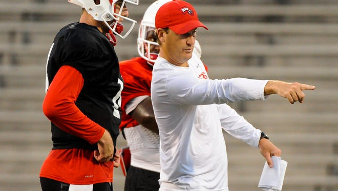 WKU Hilltoppers assistant head coach Steve Spurrier Jr., directs quarterback Mike White (14) and running back D'Andre Ferby (32) during a practice at Houchens Industries-L.T. Smith Stadium.