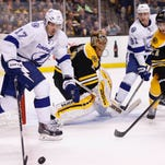 Tampa Bay Lightning left wing Alex Killorn (17) reaches for the puck in front of Boston Bruins goalie Tuukka Rask (40) during overtime  at TD Banknorth Garden.