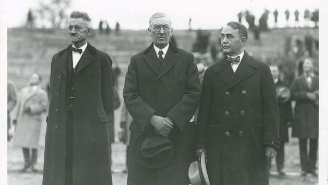 Dr. GeorgeSpitzer (left to right), George Ade, and David E. Ross are pictured during the dedication of Ross-Ade Stadium on November 22, 1924,