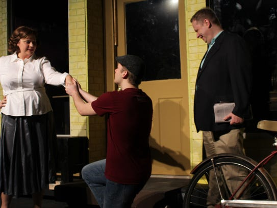 """Arpad Laszlo (Trey Smith) kneels to Ilona Ritter (Kendra Brown) while Ladislav Sipos (Tony Redman) looks on in this rehearsal scene from """"She Loves Me,"""" Abilene Community Theatre's musical that completes its two-weekend run."""