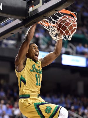 Notre Dame Fighting Irish guard Demetrius Jackson (11) scores in the first half of the championship game of the ACC Tournament at Greensboro Coliseum.
