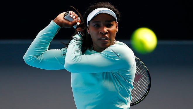 Serena Williams of the U.S. hits a shot during a practice session on Margaret Court Arena on Thursday. Williams is the top-seeded woman in the Australian Open, which begins Sunday in Melbourne.
