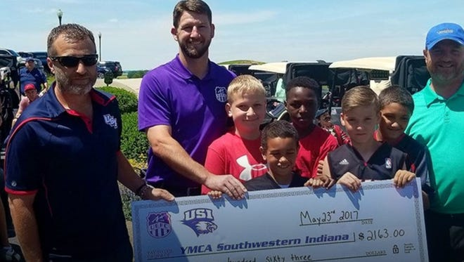 University of Southern Indiana and University of Evansville men's soccer coaches Mat Santoro and Marshall Ray present a check for $2,163 to the YMCA of Southwestern Indiana on May 23, 2017.