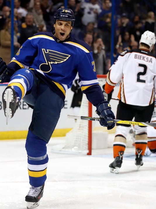 St. Louis Blues' Ryan Reaves celebrates after scoring as Anaheim Ducks' Kevin Bieksa (2) skates in the background during the second period of an NHL hockey game Friday, March 10, 2017, in St. Louis. (AP Photo/Jeff Roberson)