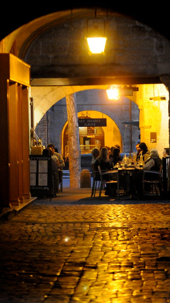 Dining under the arches in Uzès.