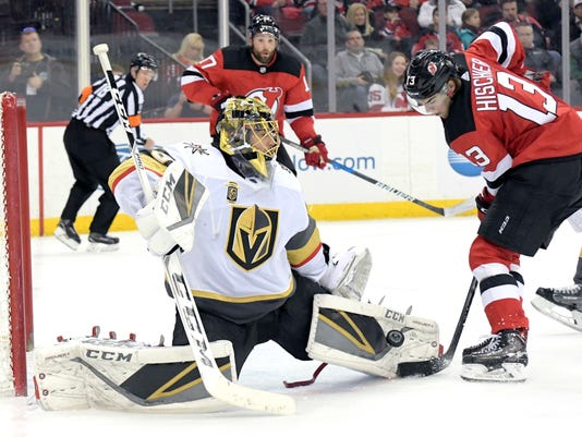 Vegas Golden Knights goaltender Marc-Andre Fleury (29) makes a stop on a shot by New Jersey Devils center Nico Hischier (13) during the second period of an NHL hockey game Sunday, March 4, 2018, in Newark, N.J. (AP Photo/Bill Kostroun)