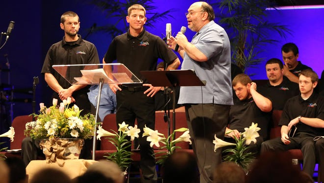 The Rev. Jim Forakis, executive director of Tennessee Valley Teen Challenge, stands alongside two young men who will graduate the one-year residency program next week at the banquet Thursday at Northside Assembly of God.
