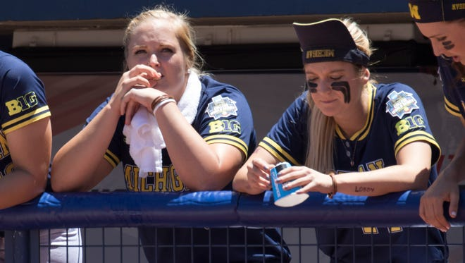 The Michigan bench reacts during final plays in Sunday's loss to Florida State in the Women's College World Series.