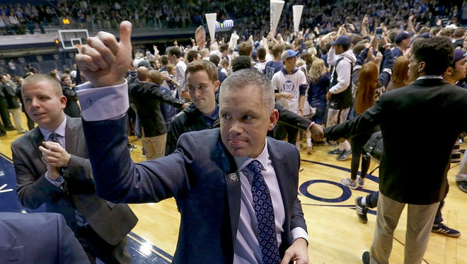 Butler Bulldogs head coach Chris Holtmann celebrates their win following their game Wednesday, December 4, 2016, evening at Hinkle Fieldhouse. The Butler Bulldogs defeated the Villanova Wildcats 66-58.