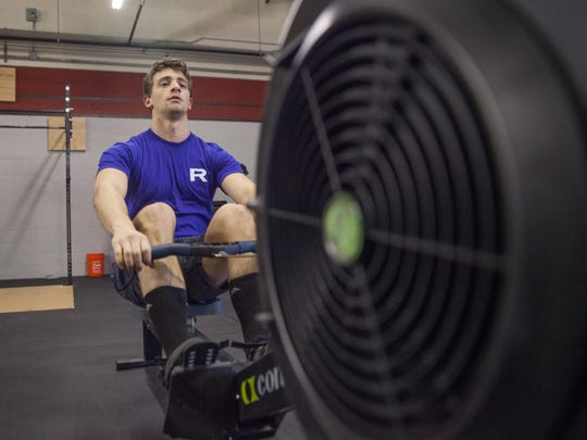 Tim Campanaro does crossfit excersizes, Firday, in Colchester. KEVIN HURLEY/for the FREE PRESS