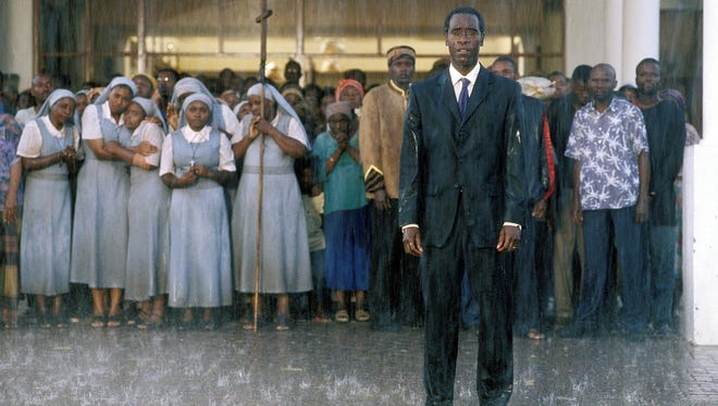 "Don Cheadle, right, stars as real-life hero Paul Rusesabagina in ""Hotel Rwanda."" The film will be shown in Fort Collins as part of film festival at The Lyric.  - (mvw) 2005"