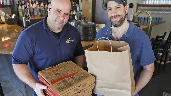 "Owners Demetri ""John"" Stavropoulos and brother George. The restaurant is named for their mother and has been serving customers since 2012.   Anna's Harborside Grille in Plymouth serving home made Greek dishes as well as pizza on Thursday, May 21, 2020 Greg Derr/The Patriot Ledger"