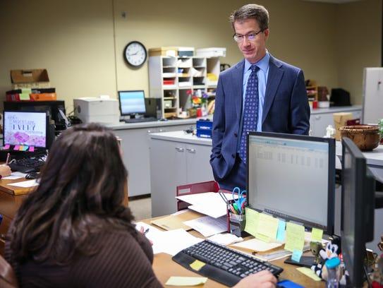 John Best, 119th District Attorney, talks to his staff