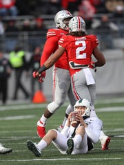 Michigan State's Messiah deWeaver is sacked by Ohio State's Chase Young in the fourth quarter in Columbus, Ohio on Saturday, Nov. 11, 2017.
