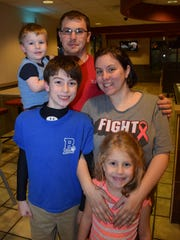 Payton Lee, 12 (front, left), with his sister Emma Lambright (front, right); his mother Kimberly Lambright (back, right); and his stepfather Justin Lambright Sr., holding Justin Lambright Jr. Payton is on the road to recovery after suffering from encephalitis to recovery from encephalitis due to human herpes simplex virus. As a result of the illness, he also suffered from encephalopathy, dysphagia and cerebral edema.