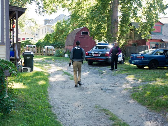 Burlington Police search the car of a resident at an